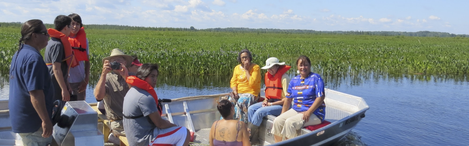 Indigenous Arts and Sciences participants on boats