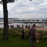 people gathering on shore of lake superior